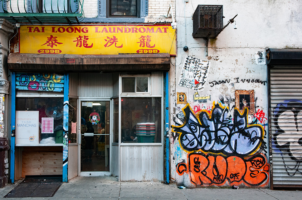 Old dirty Laundromat close to Chinatown. New York 2018