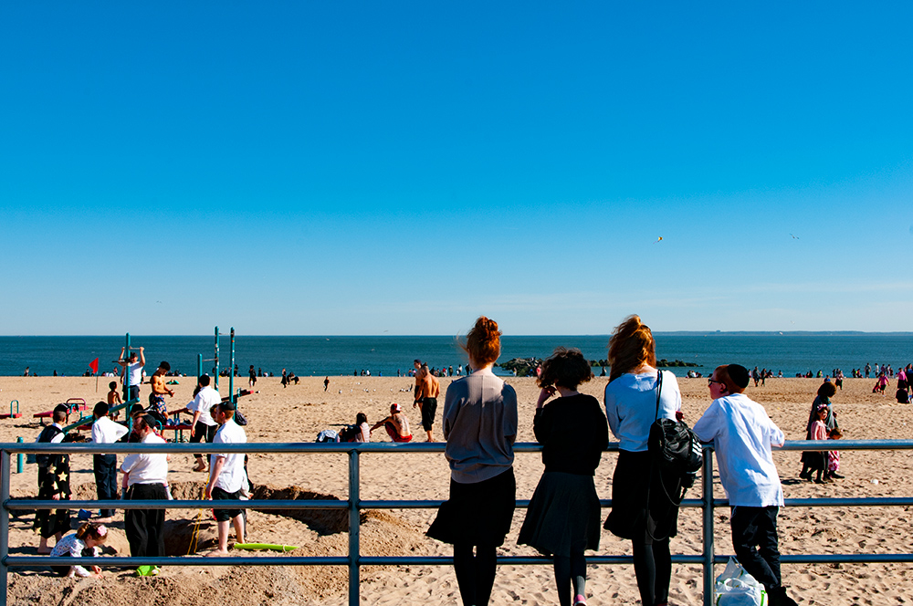 Teenagers watching people. Coney Island, Brooklyn. New York 2019.